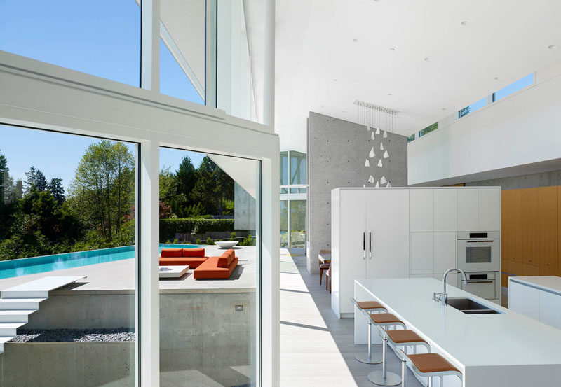The kitchen in this home is separated from the dining room by a white partition wall full of cabinets.