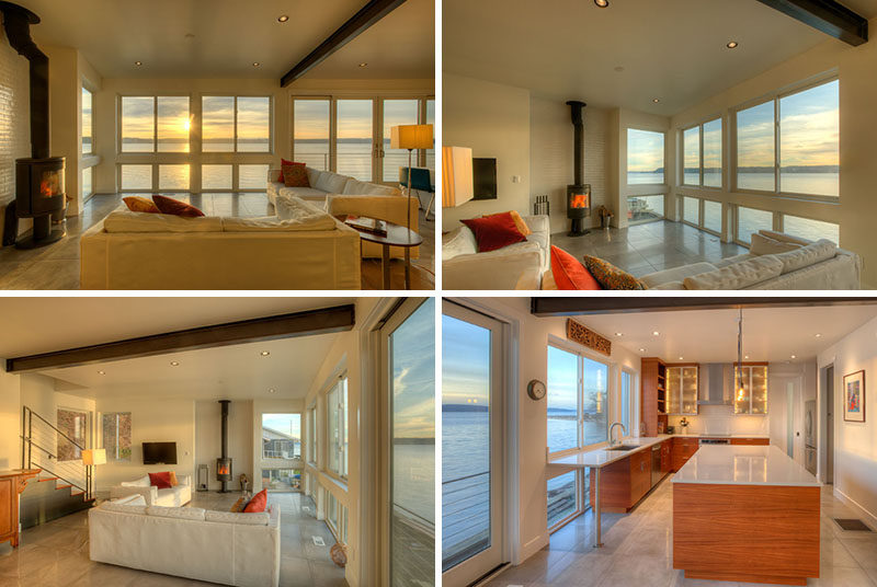 This living room and kitchen share the same space, with an entire wall of windows providing views of Puget Sound.