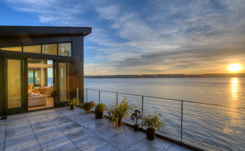 This home on an island in Washington State, has a deck on the top floor, perfect for enjoying sunsets.