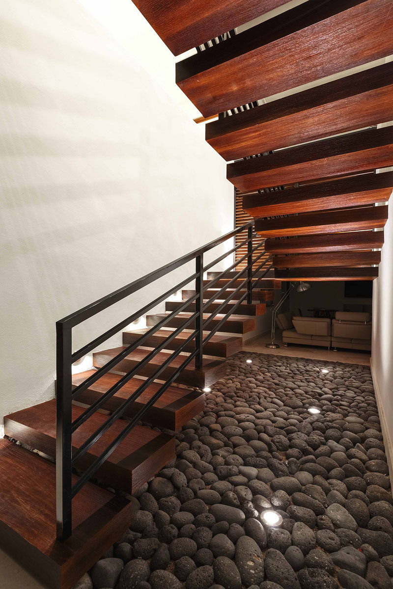 Rich dark wood and metal stairs