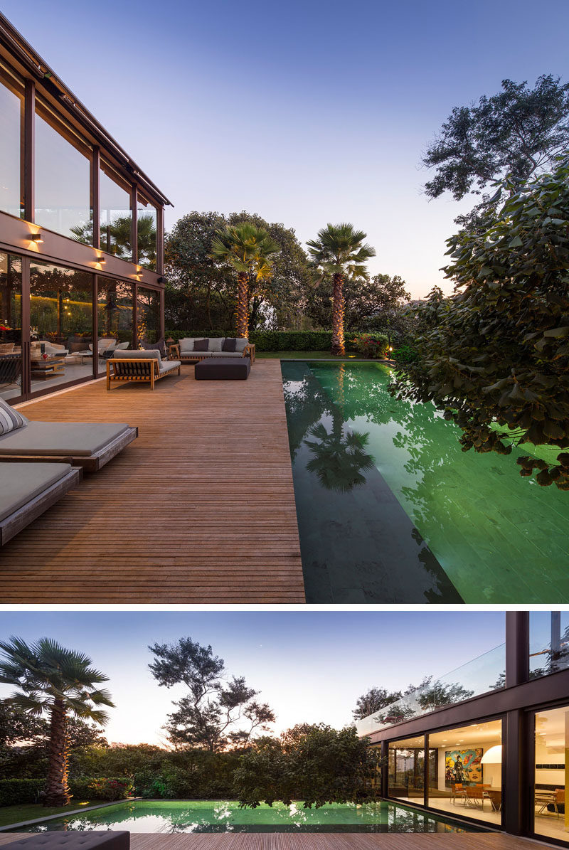 This swimming pool has a large wooden deck with various places to relax.