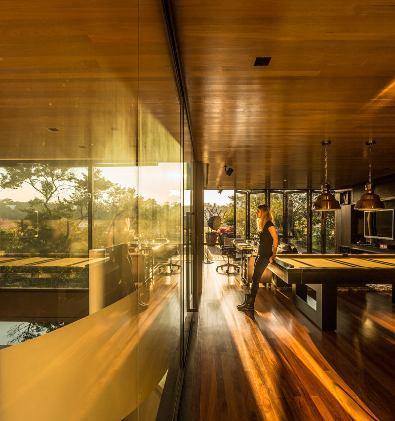The wood ceiling flows from one room to another in this Brazilian house.