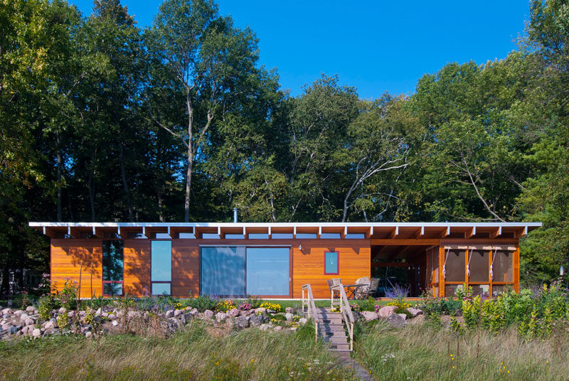 This contemporary wooden beach cottage is located on the shores of Lake Michigan.