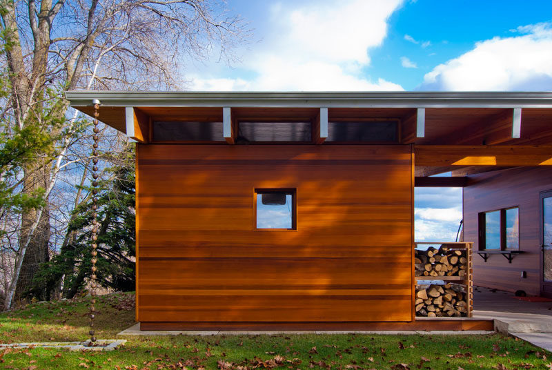 This beach cottage features a decorative rain chain, and dedicated firewood storage.