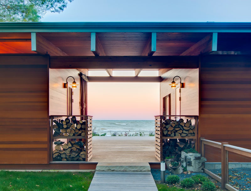 This entrance to a beach cottage gives you a glimpse of the water view beyond.