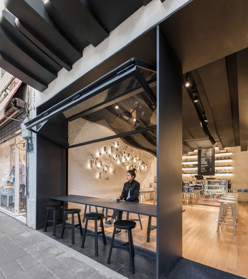 The Sculptural Ceiling In This Cafe Continues From The Inside To The Outside
