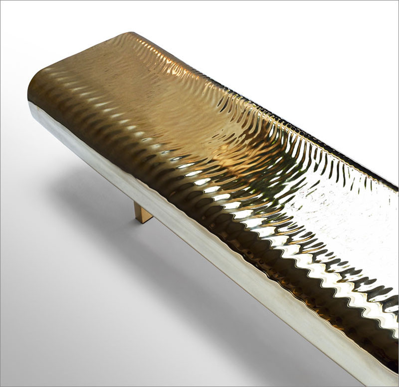 Golden Water-Like Ripples Cover This Brass Bench