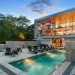 This Hampton's Home Is Surrounded By A Forest Of Trees