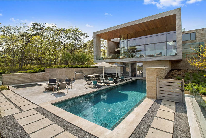 This home, designed by Barnes Coy Architects, sits on 1.5+ acres, and has a landscaped yard, an outdoor swimming pool and deck, perfect for entertaining.