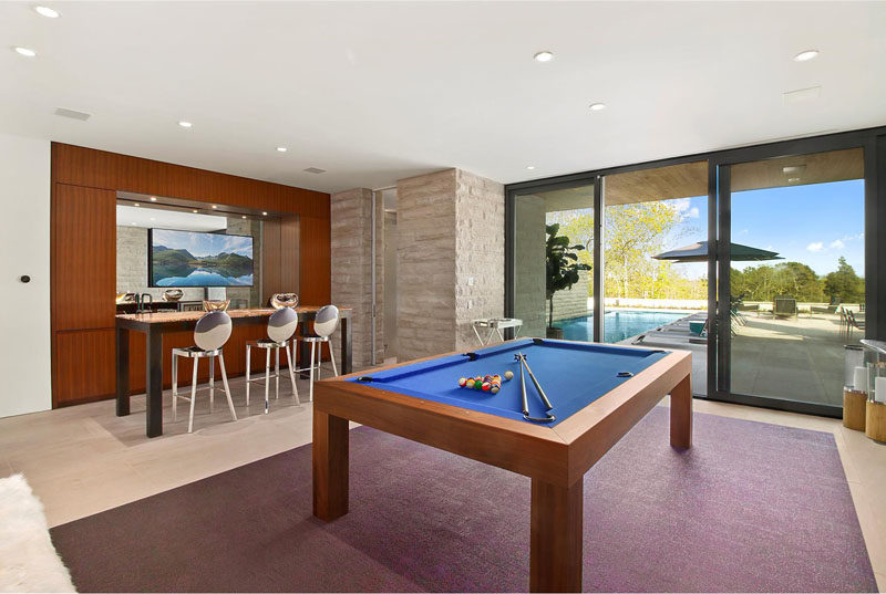 This games room and bar area are located just off the swimming pool, making it perfect for entertaining.