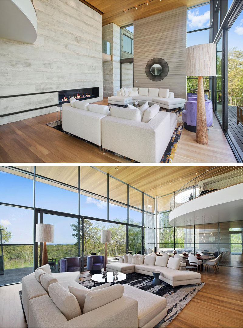 Heading upstairs is the main open plan living area. The large double-height ceiling makes the space feel open and airy, and the wall of windows provides amazing views, and opens out onto the balcony.