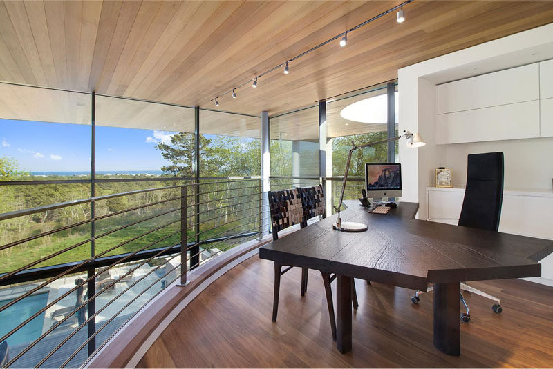 This home office has amazing views, and overlooks the swimming pool below.