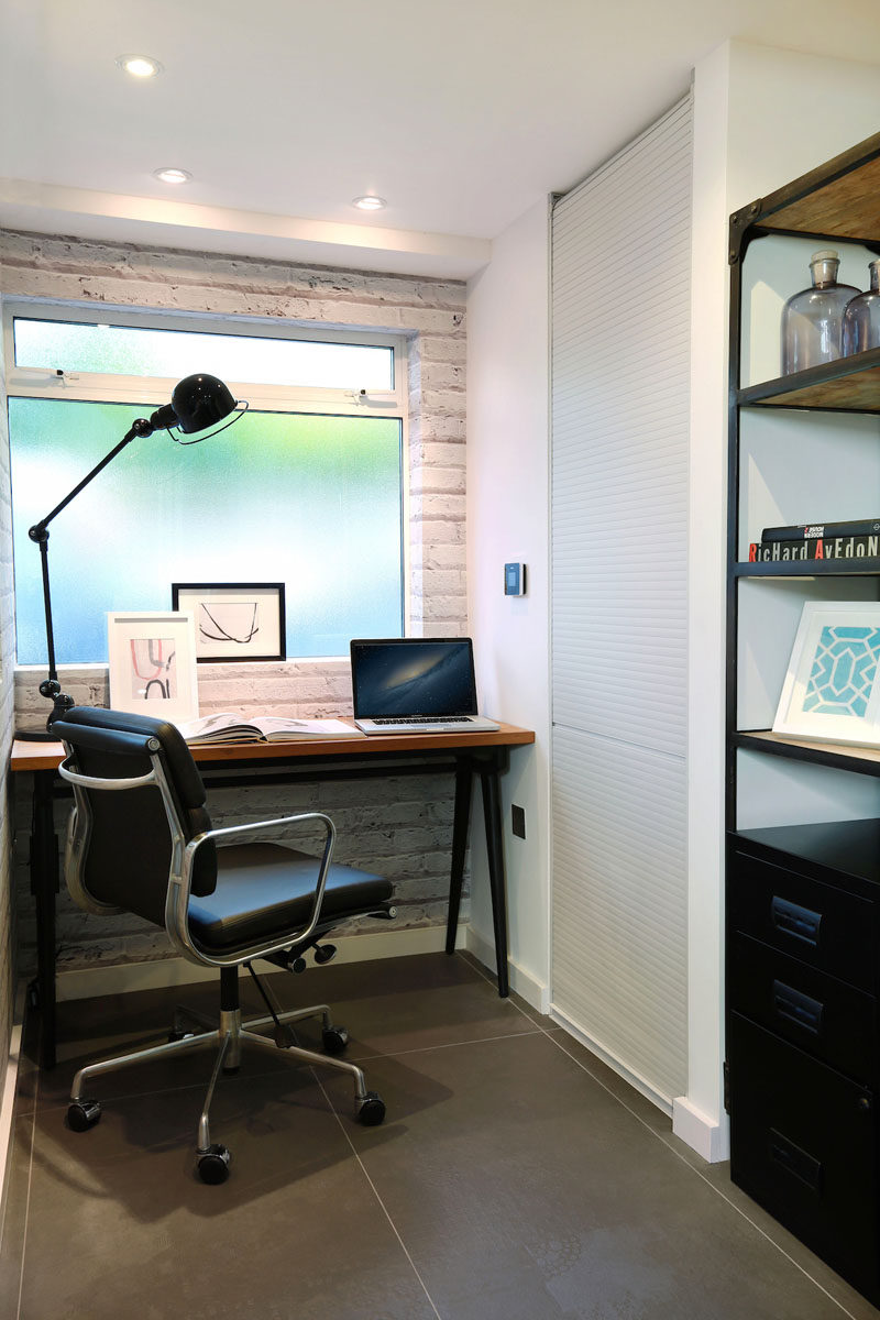 Distressed white brick wallpaper gives this small office area a feeling of texture.