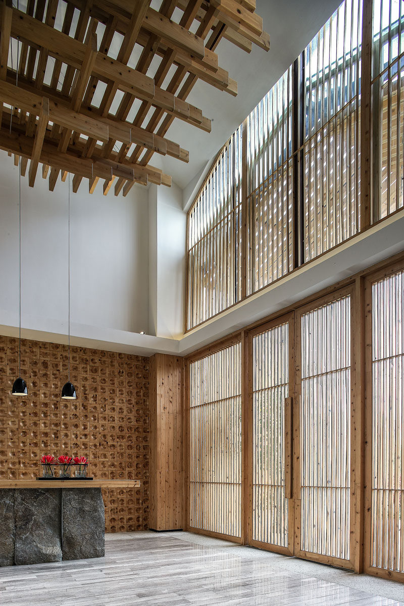 This reception area is flooded with natural light from the large windows, but at the same time, the wooden slats provide a shaded element.