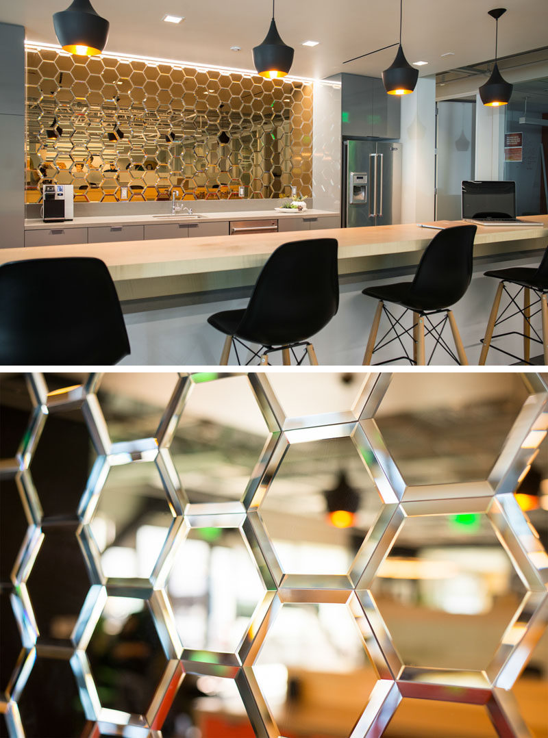19 Ideas For Using Hexagons In Interior Design And Architecture // Mirrored glass hexagons make up the backsplash of the kitchen area in this LA production studio.