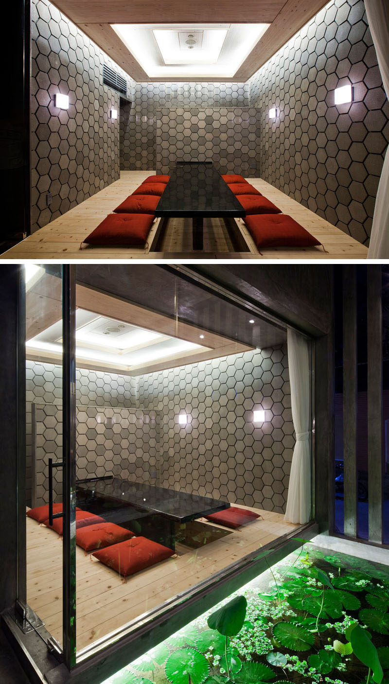19 Ideas For Using Hexagons In Interior Design And Architecture // The walls of this private annex at sushi restaurant in Vietnam, are made up of dark grey hexagons.