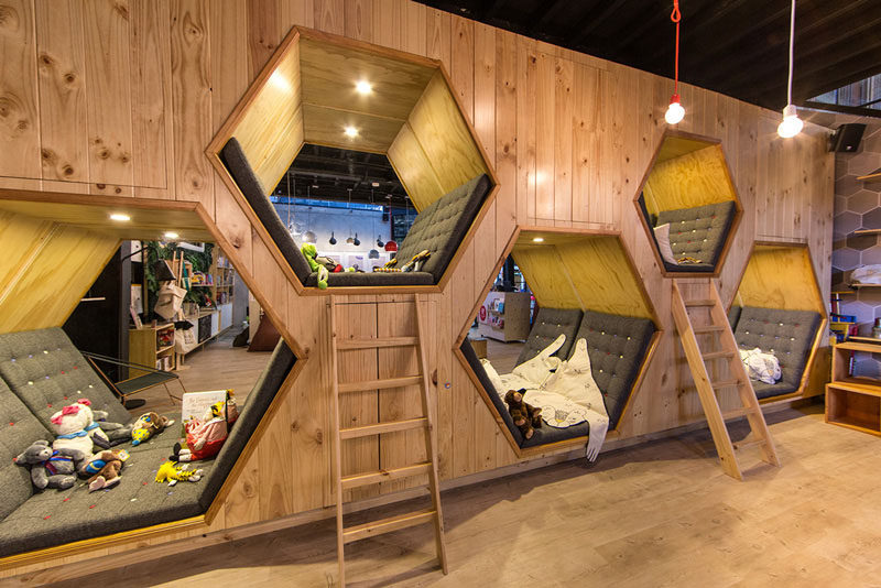 19 Ideas For Using Hexagons In Interior Design And Architecture // The 9 3/4 Bookstore + Cafe has hexagon shaped hideaway spaces for extra cozy reading.