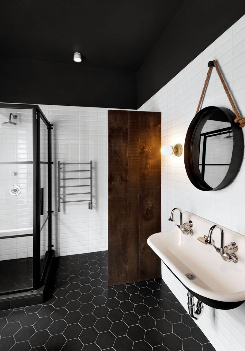 19 Ideas For Using Hexagons In Interior Design And Architecture // Black hexagon tiles make a dramatic statement in this bathroom.