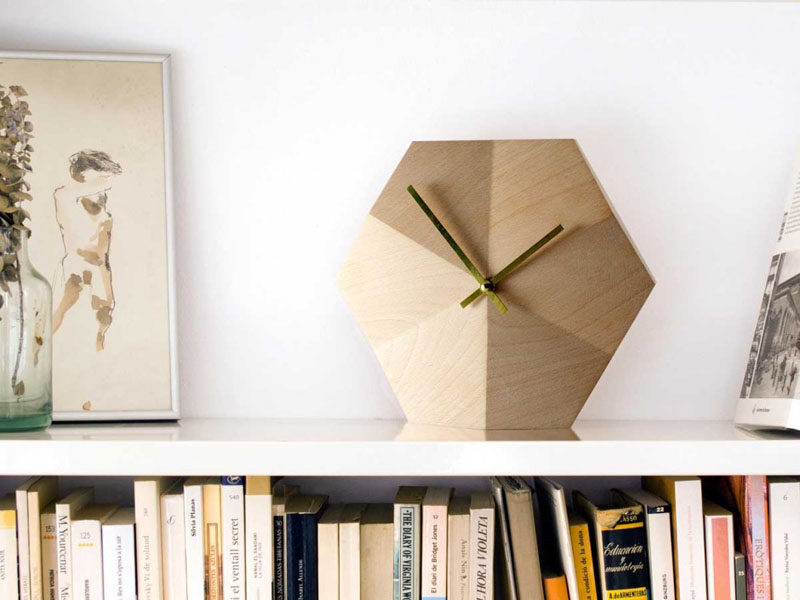 19 Ideas For Using Hexagons In Interior Design And Architecture // This hexagonal wall clock is a great way to bring the trend into your home without covering your walls or floors.