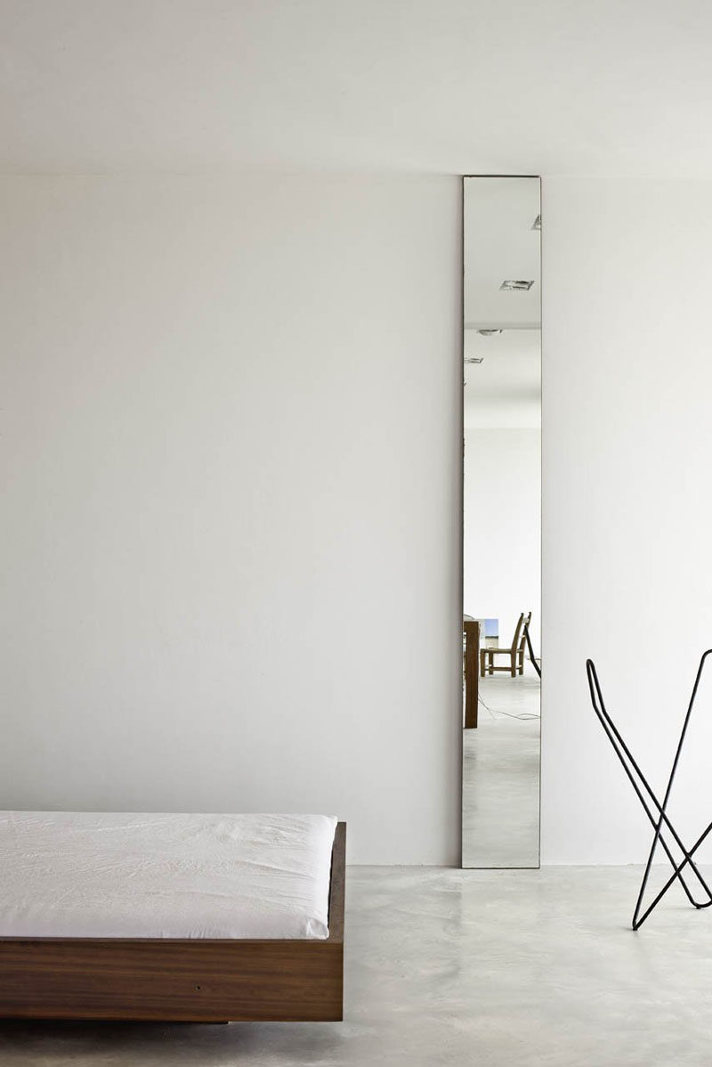 11 Ideas For Making Your Room Feel Taller // Long Mirrors -- As they reflect a lot of light, mirrors are a great way to make any space feel larger. And, if they're positioned vertically, they make the space feel taller by drawing the eye upward.