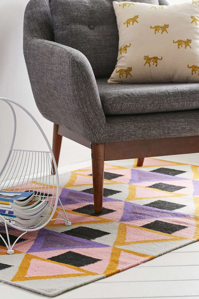 11 Ideas For Making Your Room Feel Taller // Be Bold -- Bold floor rugs will keep the focus at ground level and distract from the height of the ceiling, making the space feel taller.