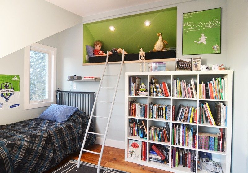 11 Kids Only Hideouts That Even The Biggest Grownups Would Be Jealous Of // This boys bedroom includes reading loft with comfy furnishings.