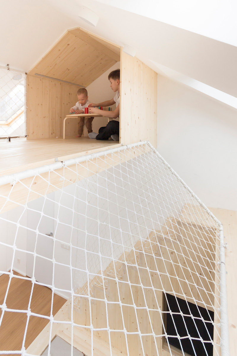 11 Kids Only Hideouts That Even The Biggest Grownups Would Be Jealous Of // This private play area at the top of the stairs is perfect for a kids getaway.