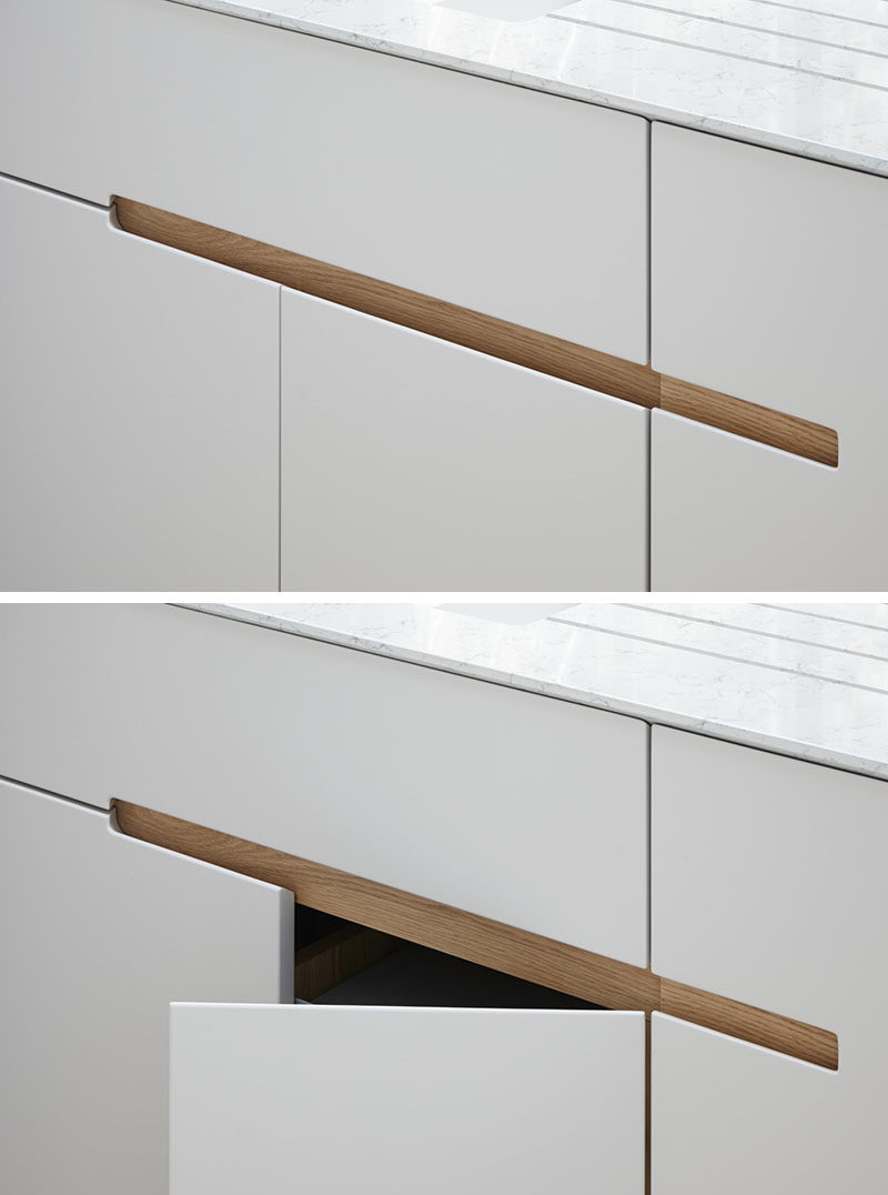 No hardware for the kitchen cabinets in this london home contemporist Fingertip design kitchen door handles