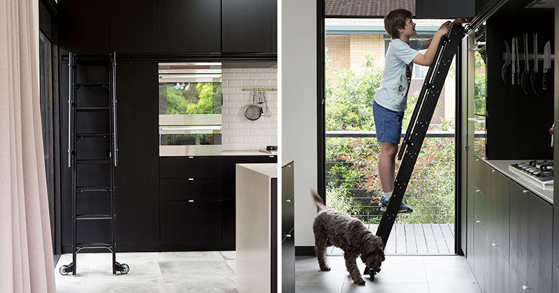 This Matte Black Kitchen Has A Rolling Ladder To Reach The Upper Cabinets