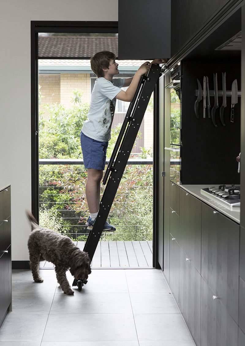 This Kitchen Has A Rolling Ladder To Reach The Upper