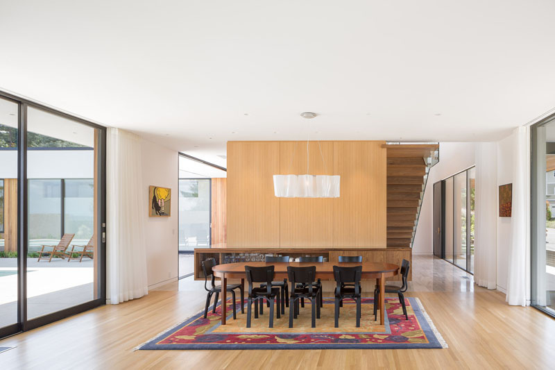 In the dining area, natural light floods the space from the windows on either side of the home.