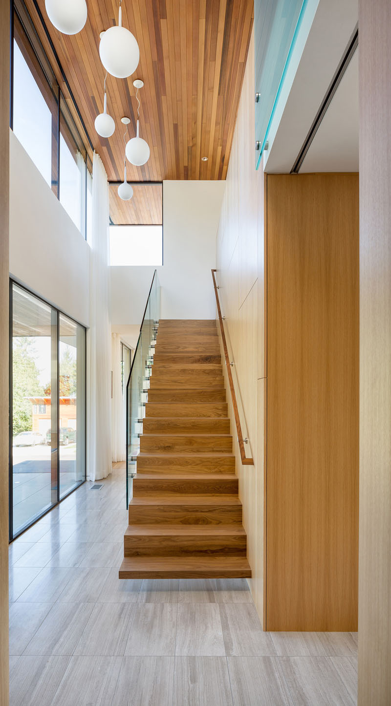 Leading you up to the roof terrace of this home, are cantilevered walnut stairs.