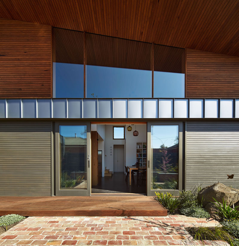 Sliding doors connect the landscaped yard with the interior of this home.