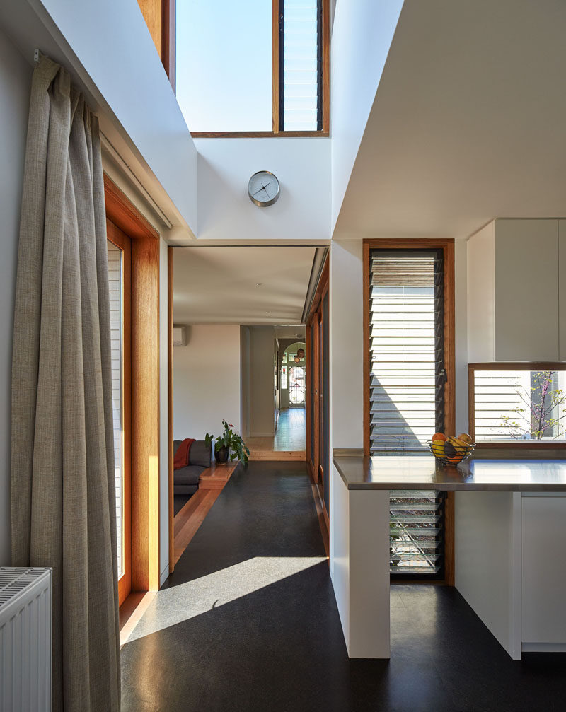 A long hallway connects the original home with the new extension in this Australian house.