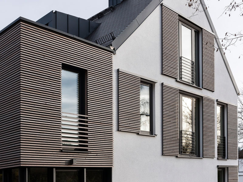 This House Has Modern Window Shutters That Match The Wooden Siding Used On