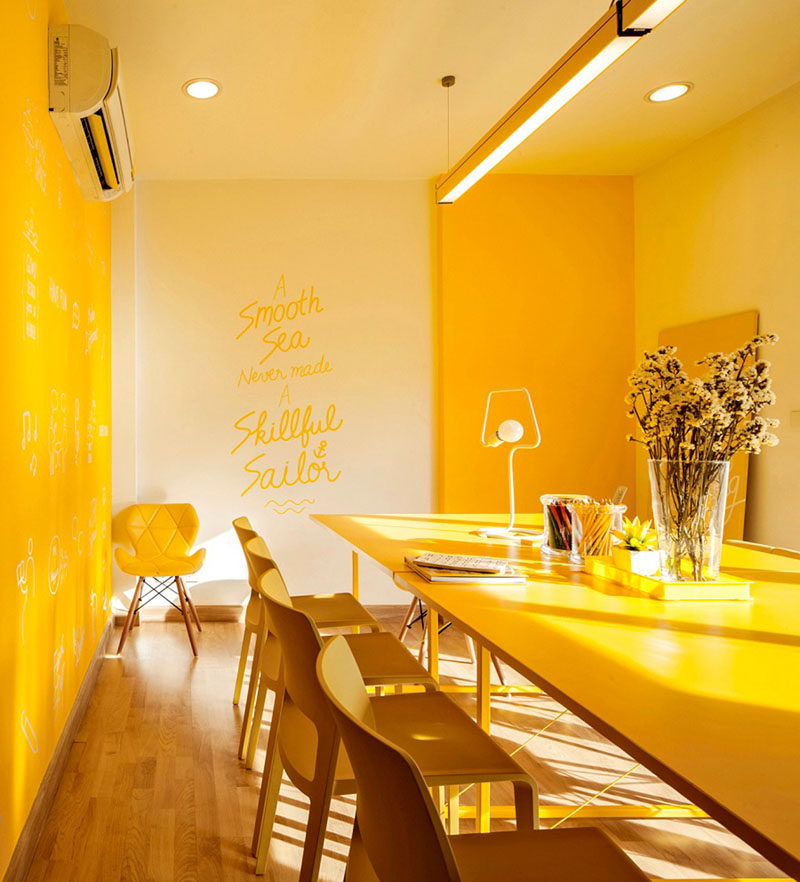10 Examples Of Monochromatic Interiors // Meetings are made much more cheerful in this yellow office.