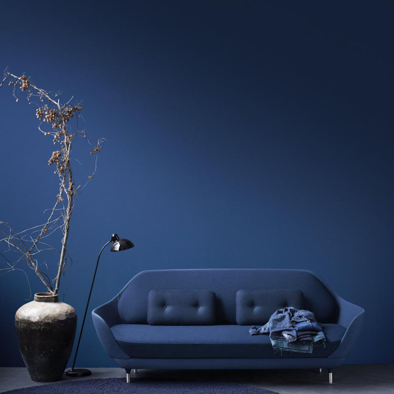 10 Examples Of Monochromatic Interiors // This deep blue wall matches the sofa, blanket and rug.