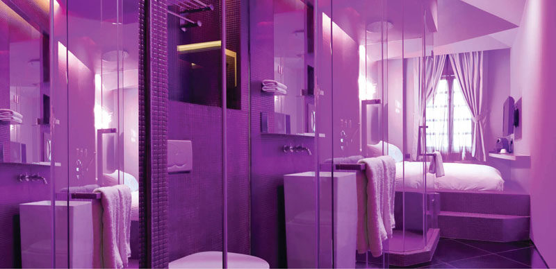 10 Examples Of Monochromatic Interiors // The Wanderlust hotel in Singapore has a series of rooms inspired by Pantone colors, like this purple hotel suite.