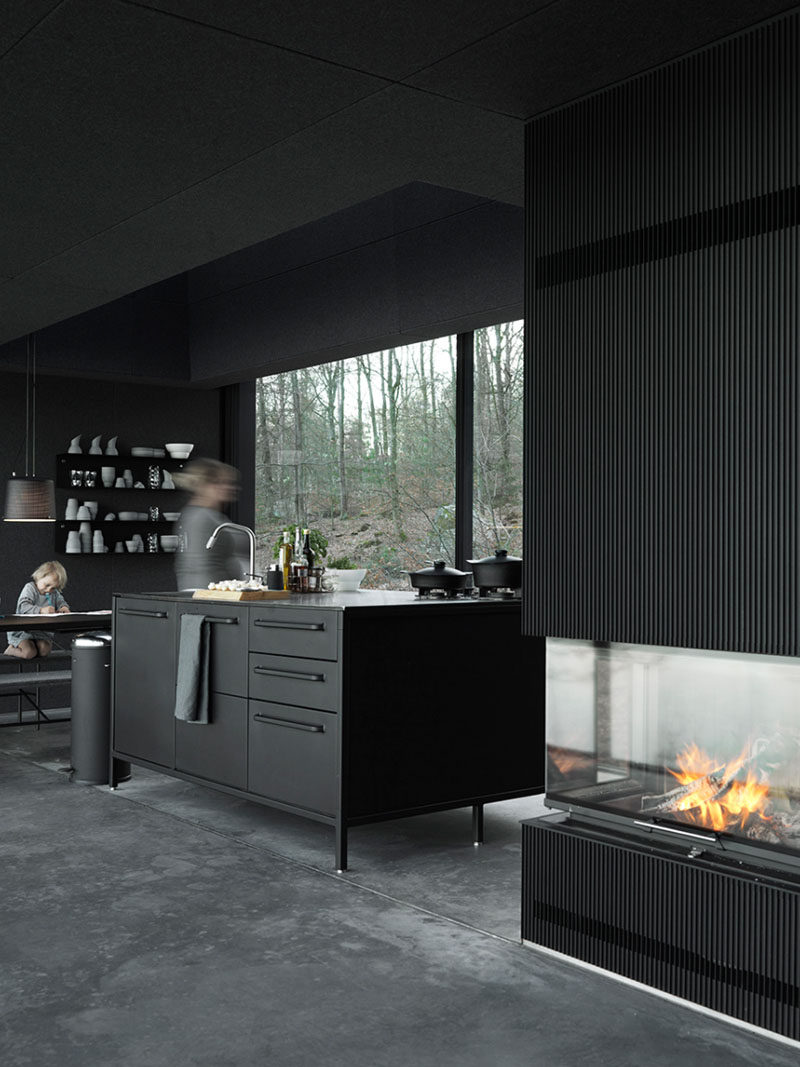 10 Examples Of Monochromatic Interiors // The Vipp Shelter has a completely black interior including the kitchen.