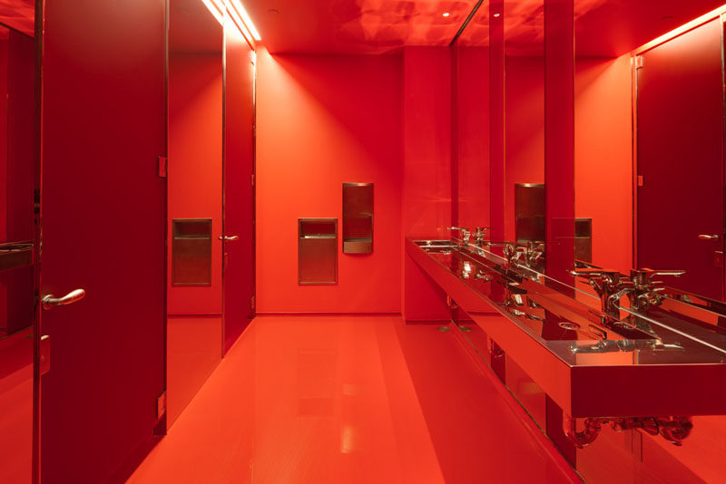 10 Examples Of Monochromatic Interiors // In keeping with their name, Red Bull's bathroom in their New York Music school is bright red.