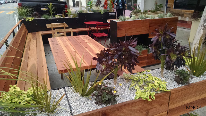 This modern wood and steel parklet outside a bakery in San Francisco, is surrounded by herbs and succulents, and was designed to increase the foot traffic outside their location and at the same enhance the street.