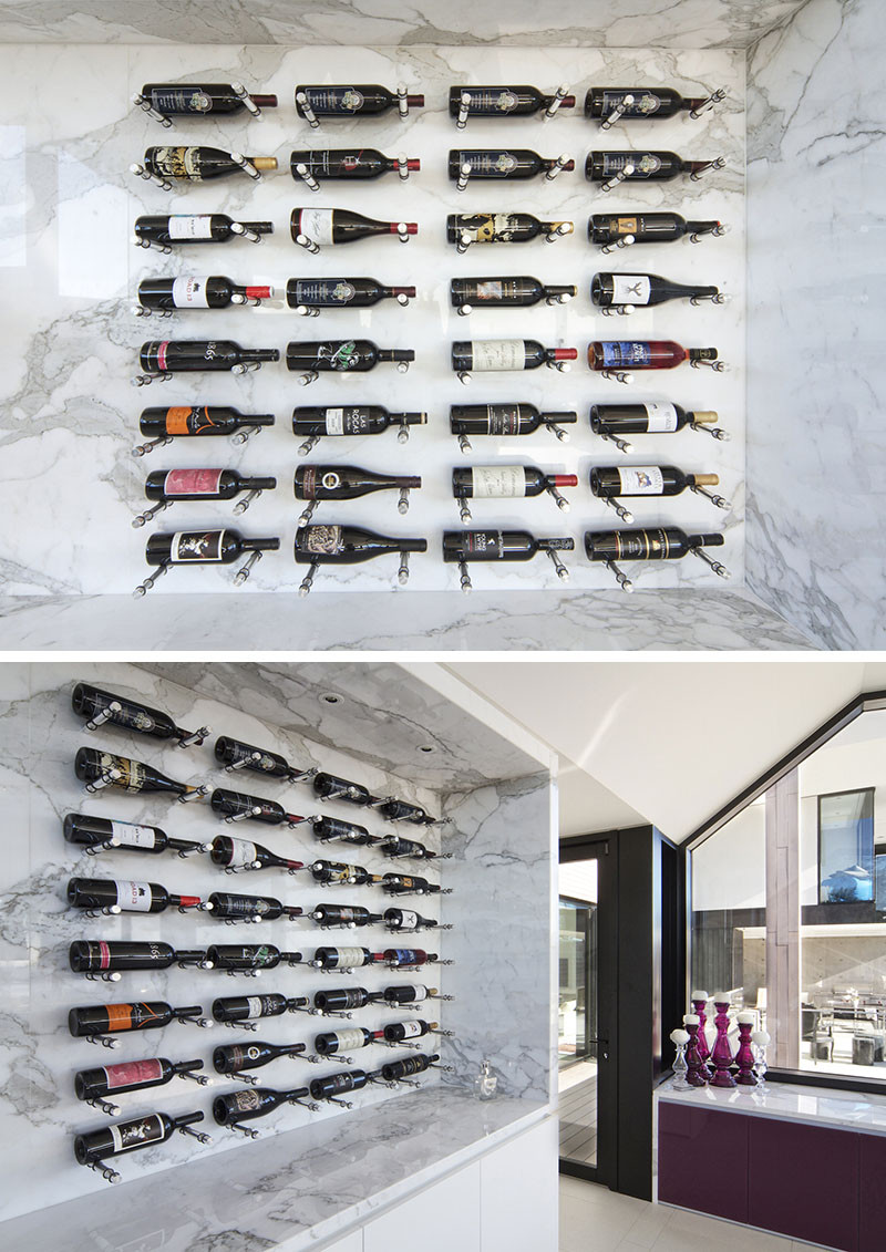 9 Ideas For Using Pegboard And Dowels To Create Open Shelving // Organize your wine on these custom made wine walls that use pegboard principles to keep the bottles in place.