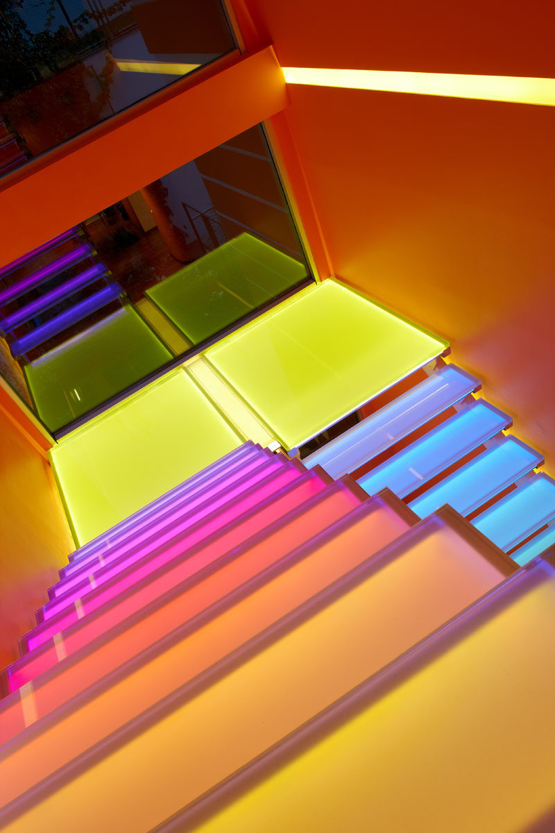 7 Inspiring Examples Of Rainbow Stairs // These stairs have hidden lighting so they can be lit up in a rainbow of colors