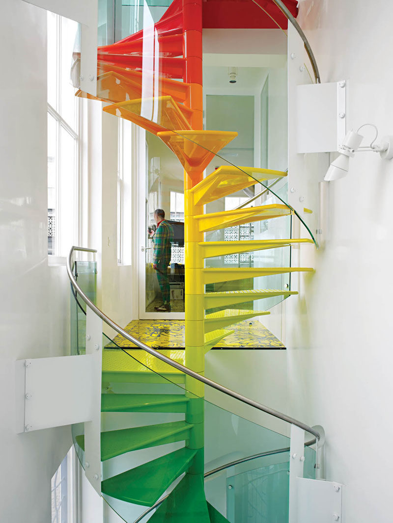 7 Inspiring Examples Of Rainbow Stairs // These rainbow spiral stairs add some color to this London home.