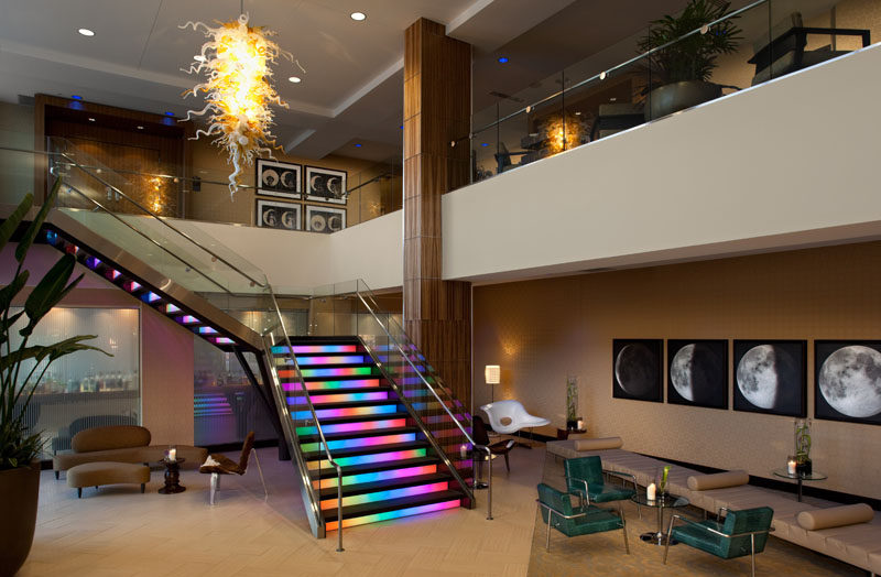 7 Inspiring Examples Of Rainbow Stairs // The staircase in the lobby of the Moonrise Hotel in St.Louis, Missouri, is known for it's rainbow lights.