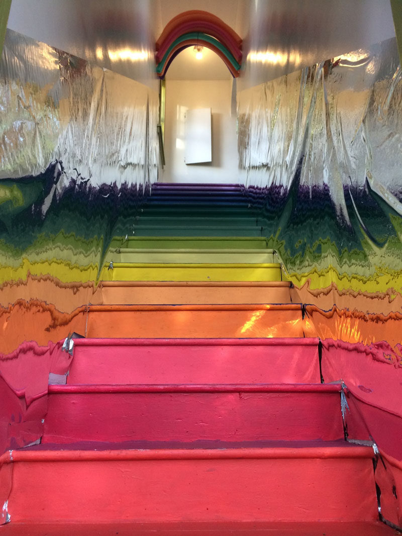 7 Inspiring Examples Of Rainbow Stairs // The walls of this rainbow staircase are lined with foil making the rainbow reflect back and forth.