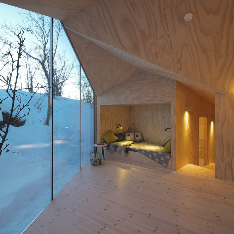 10 Reading Nooks Perfect For Curling Up In // This little nook in a Norwegian cabin is a perfect place to snuggle into with a good book and mug of hot chocolate.