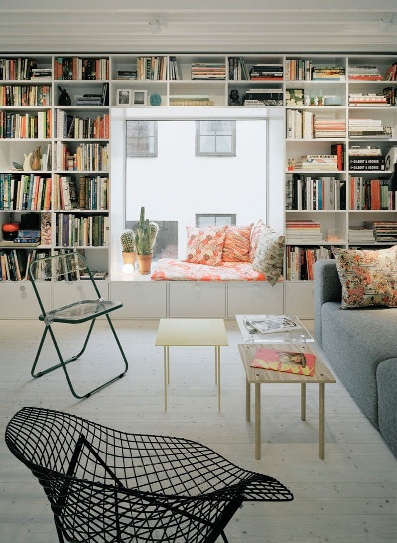 10 Reading Nooks Perfect For Curling Up In // Curl up and read one of the books that surround this window nook.