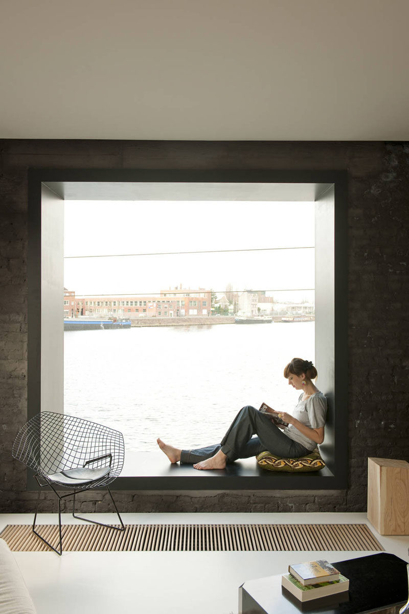 10 Reading Nooks Perfect For Curling Up In // This window seat is a great place to sit and read, or watch the boats go by outside.