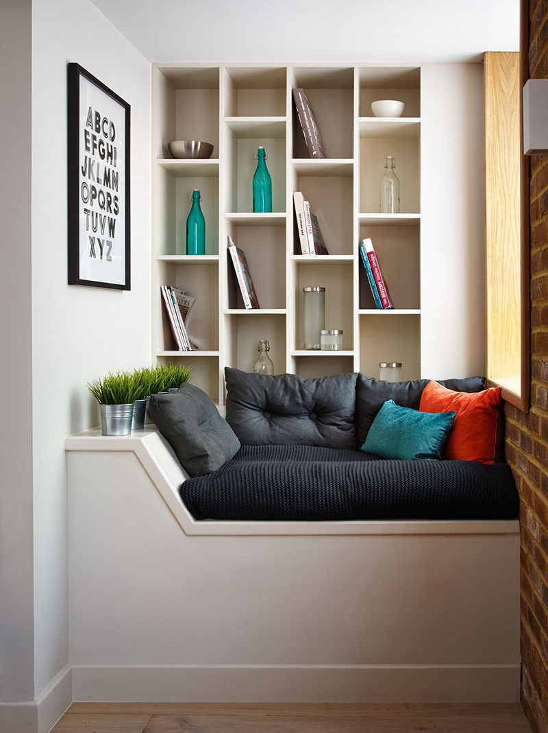 10 Reading Nooks Perfect For Curling Up In // It would be easy to spend an entire day lounging on the pillows, looking out the window, and reading your favorite book in this little nook.